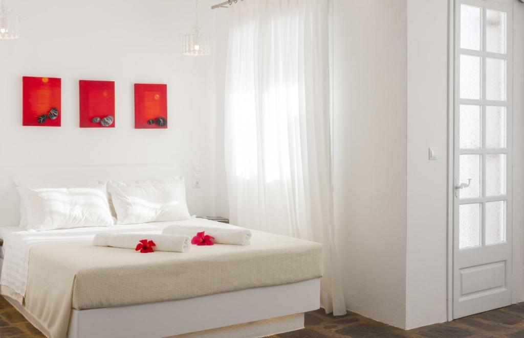 A bed or beds in a room at Scorpios Hotel & Suites