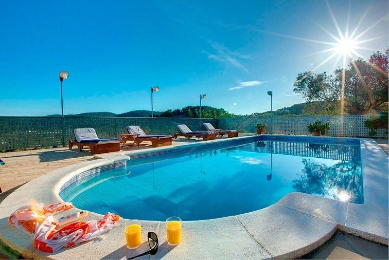 The swimming pool at or near Villa Can Lluc