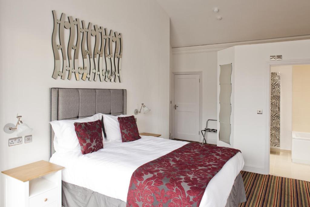 מיטה או מיטות בחדר ב-Burton Stone Inn