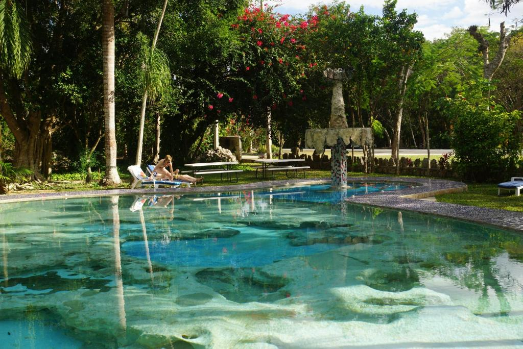 The swimming pool at or near Hotel Doralba Inn Chichen