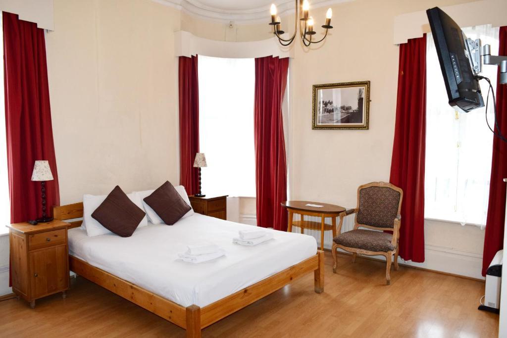 Un ou plusieurs lits dans un hébergement de l'établissement The Black Lion