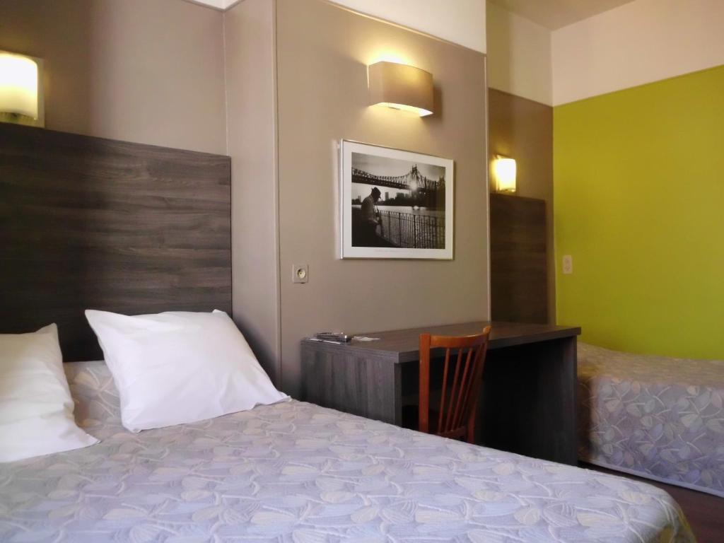 Cama o camas de una habitación en Hotel Du Dauphiné
