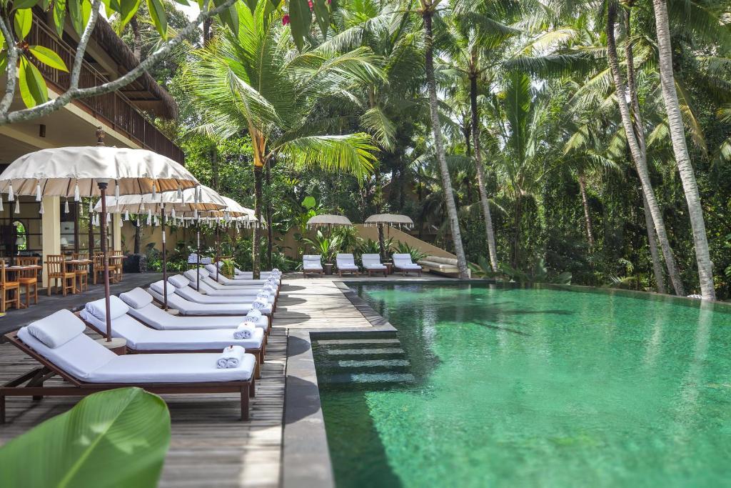 The swimming pool at or near Komaneka at Rasa Sayang Ubud