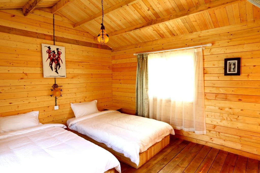A bed or beds in a room at Jambo Mara Safari Lodge