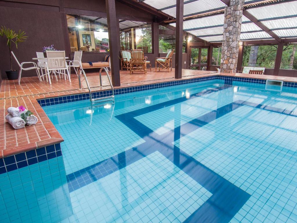 A piscina localizada em Pousada Jardim das Montanhas ou nos arredores