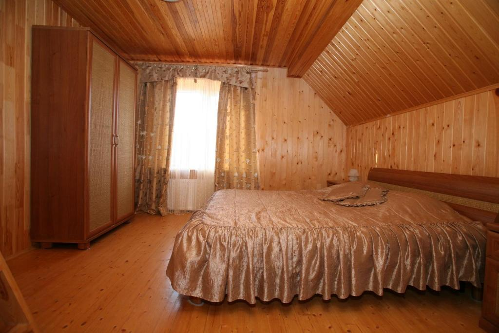 A bed or beds in a room at Zolotye Peski