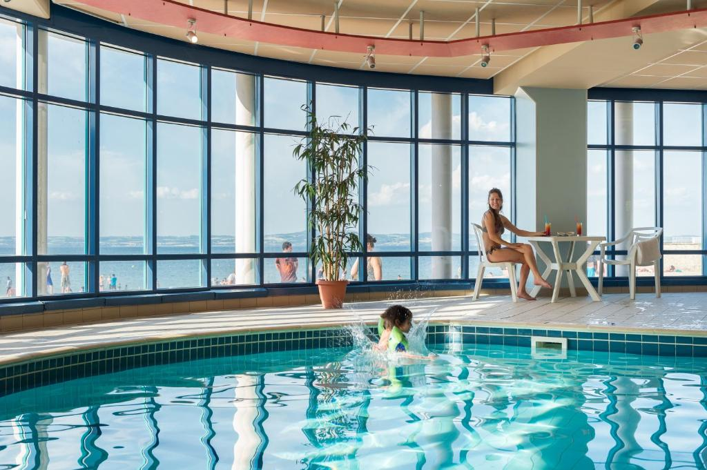 The swimming pool at or near The Originals City, Les Résidences d'Armor, Douarnenez (Inter-Hotel)