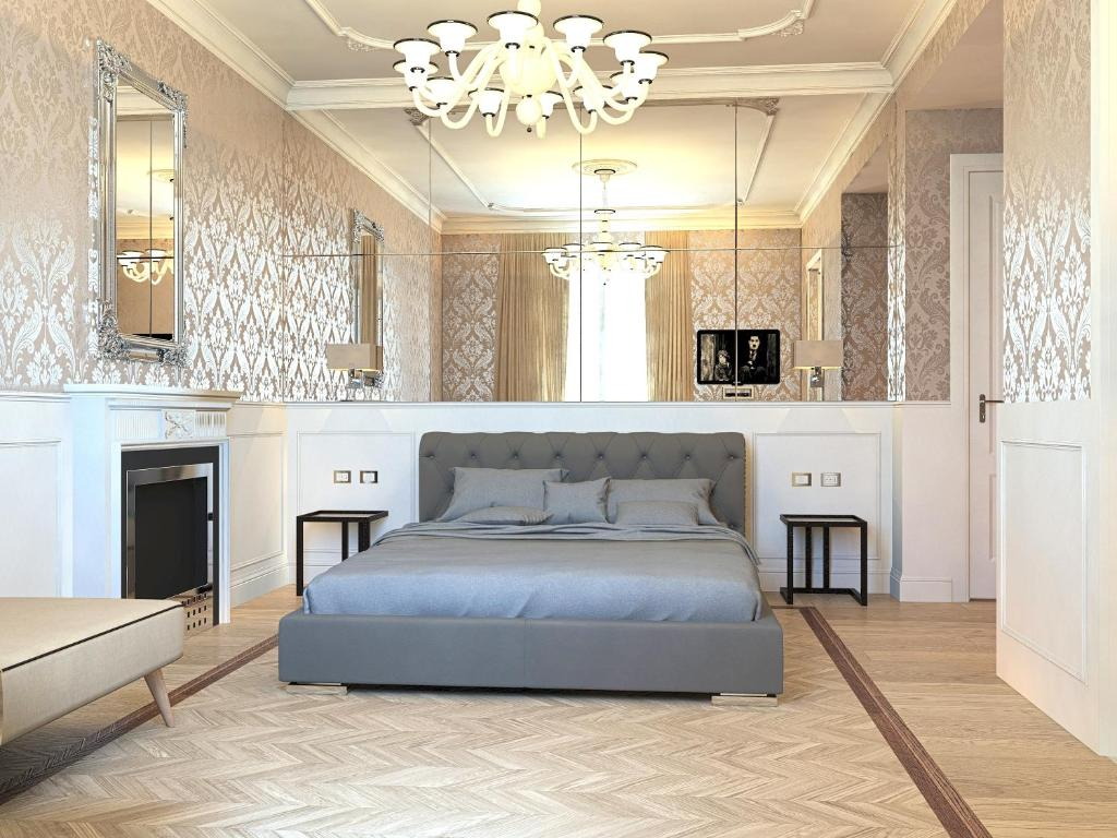 A bed or beds in a room at Duomo Rooms