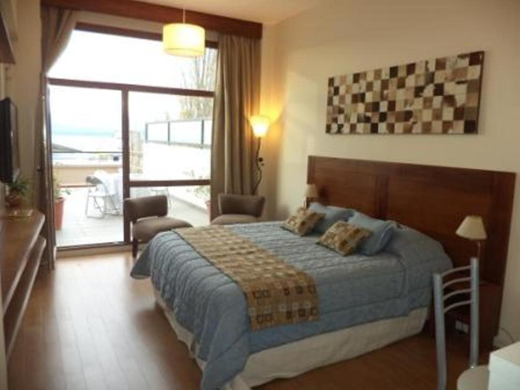 Una cama o camas en una habitación de Bariloche Downtown 2