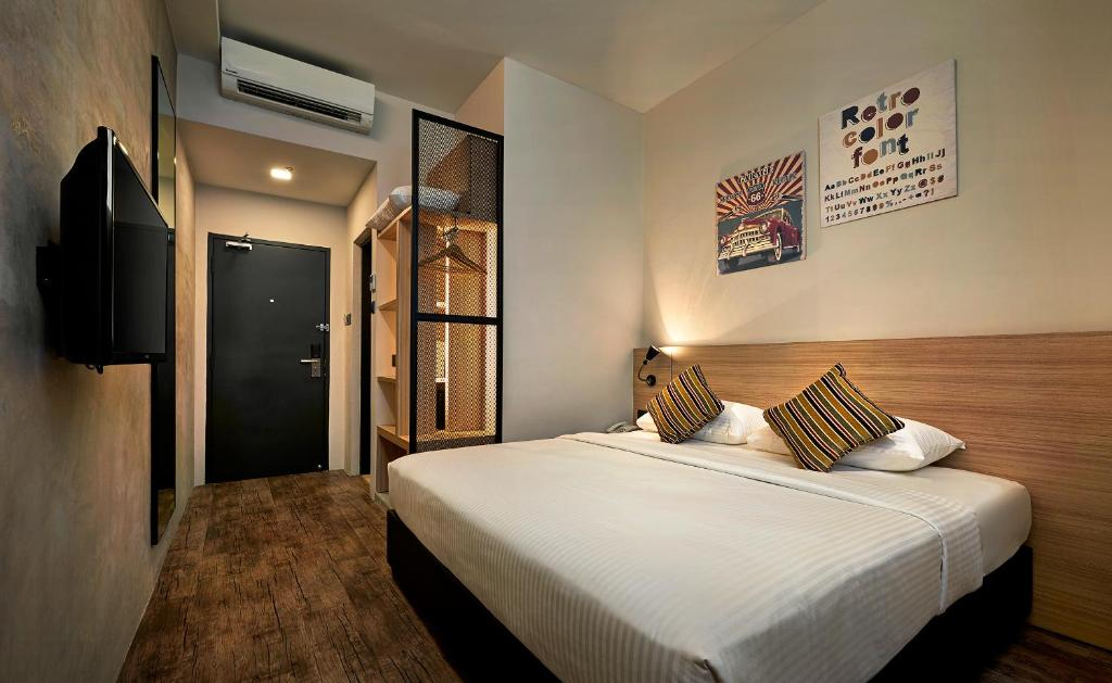 A bed or beds in a room at U Hotel Penang