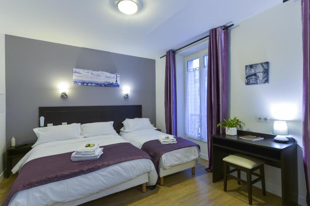 Un ou plusieurs lits dans un hébergement de l'établissement Hôtel du Quai de Seine
