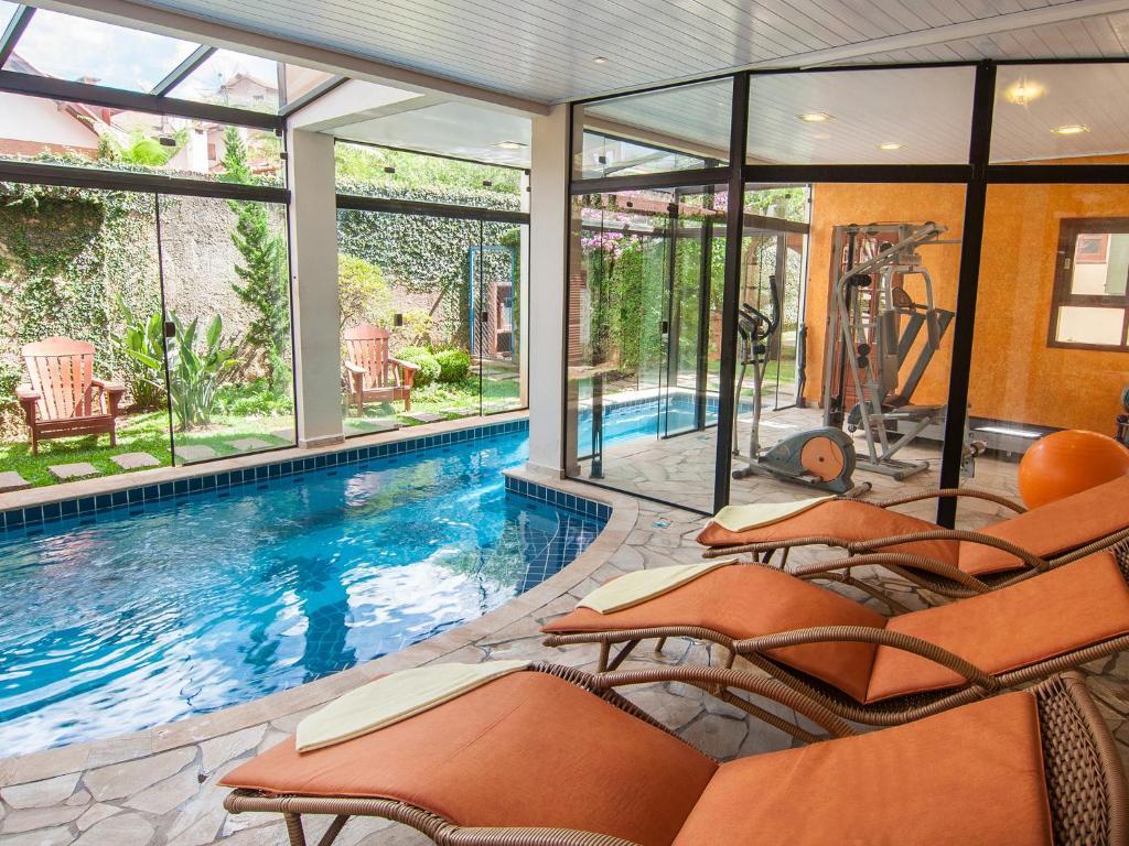 The swimming pool at or near Pousada Aguia Dourada