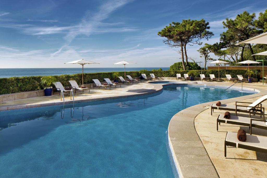 בריכת השחייה שנמצאת ב-Senhora da Guia Cascais Boutique Hotel או באזור