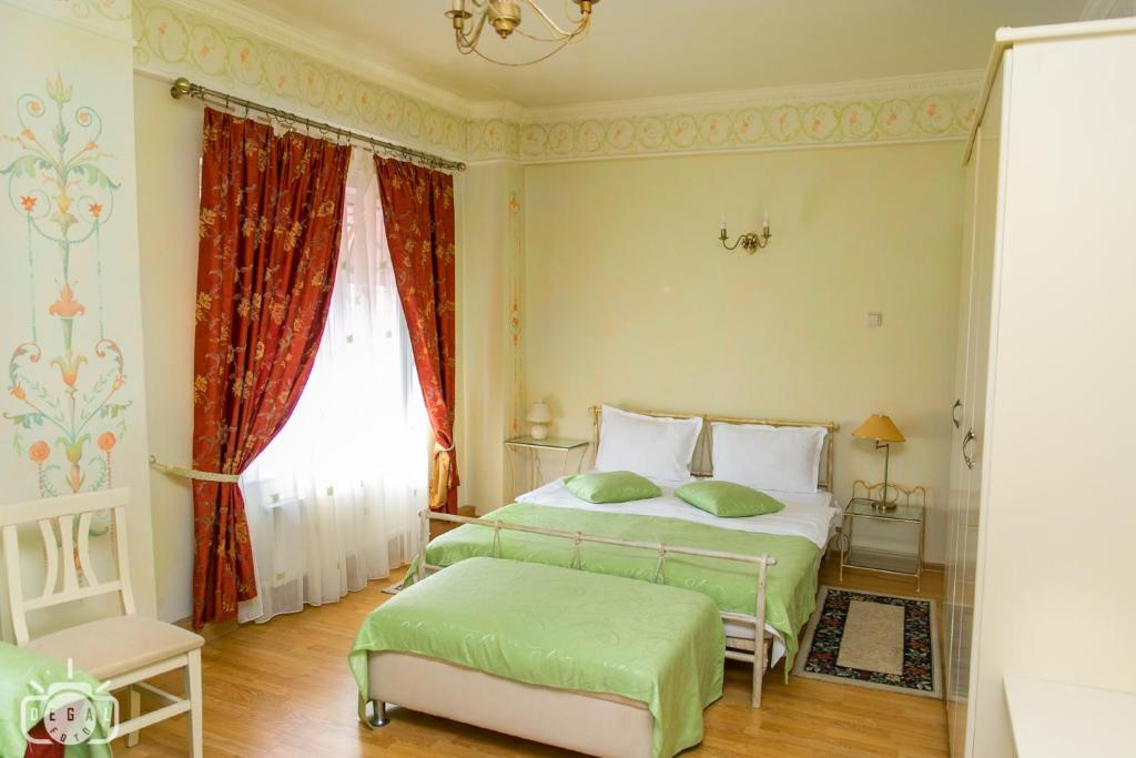 A bed or beds in a room at Villa Tamara