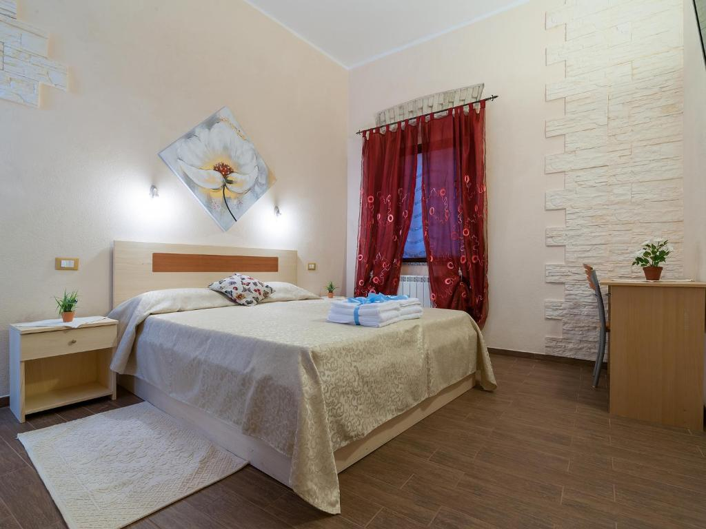 A bed or beds in a room at Il Borgo