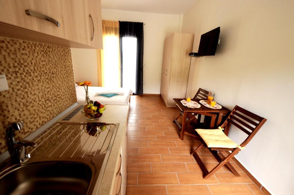 A kitchen or kitchenette at Alba Studio Thassos