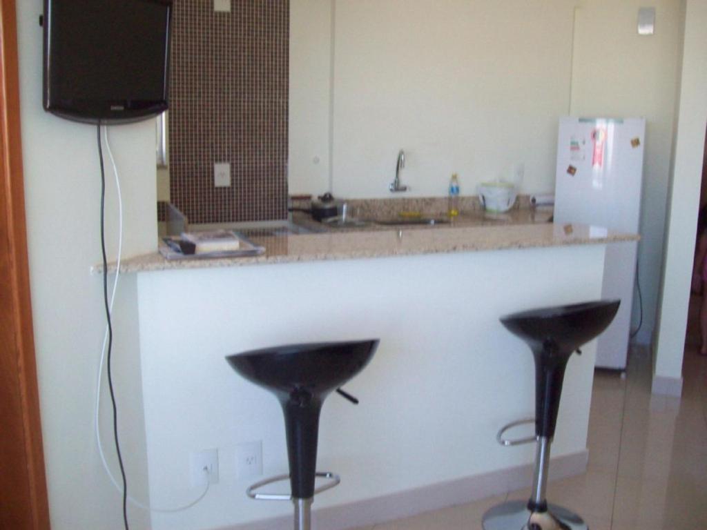A kitchen or kitchenette at Flat Residence bela Vista bueno