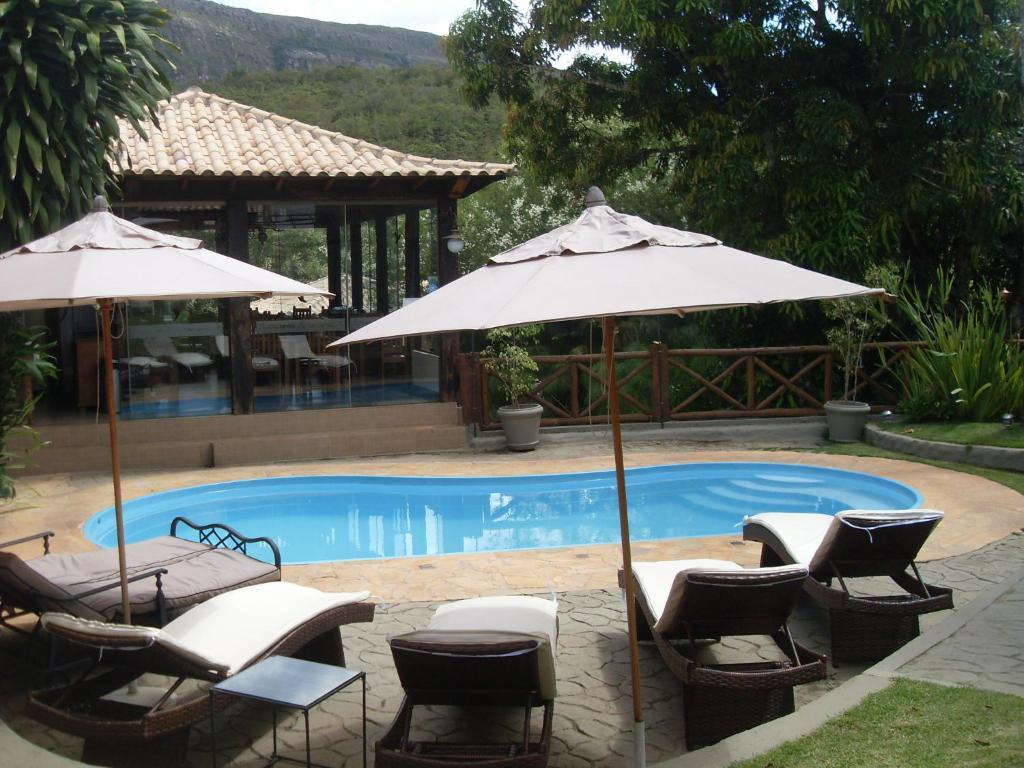 The swimming pool at or near Pousada Papyrus