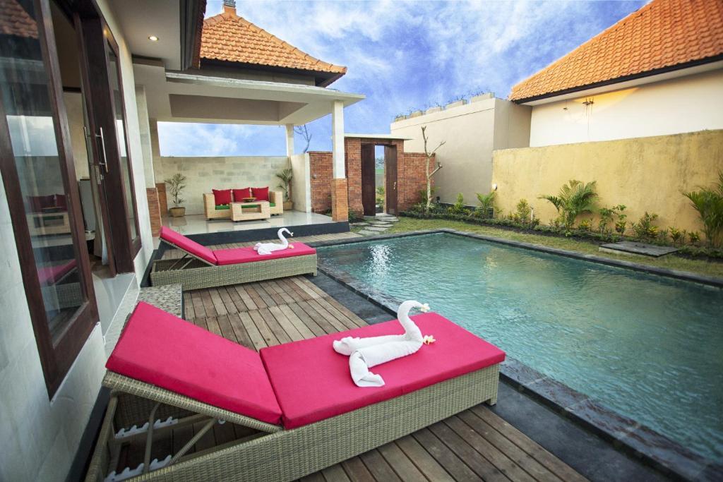 Piscine de l'établissement The Sawah Resort & Villa ou située à proximité