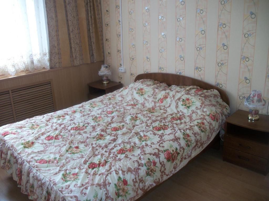 Кровать или кровати в номере Гостиница Лебедь