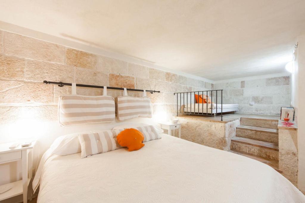 Cama o camas de una habitación en Cuore di Pietra B&B