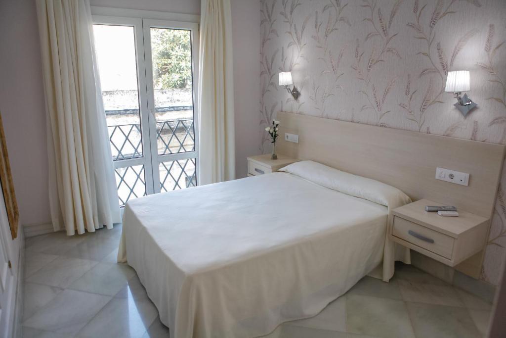 מיטה או מיטות בחדר ב-Chaikana