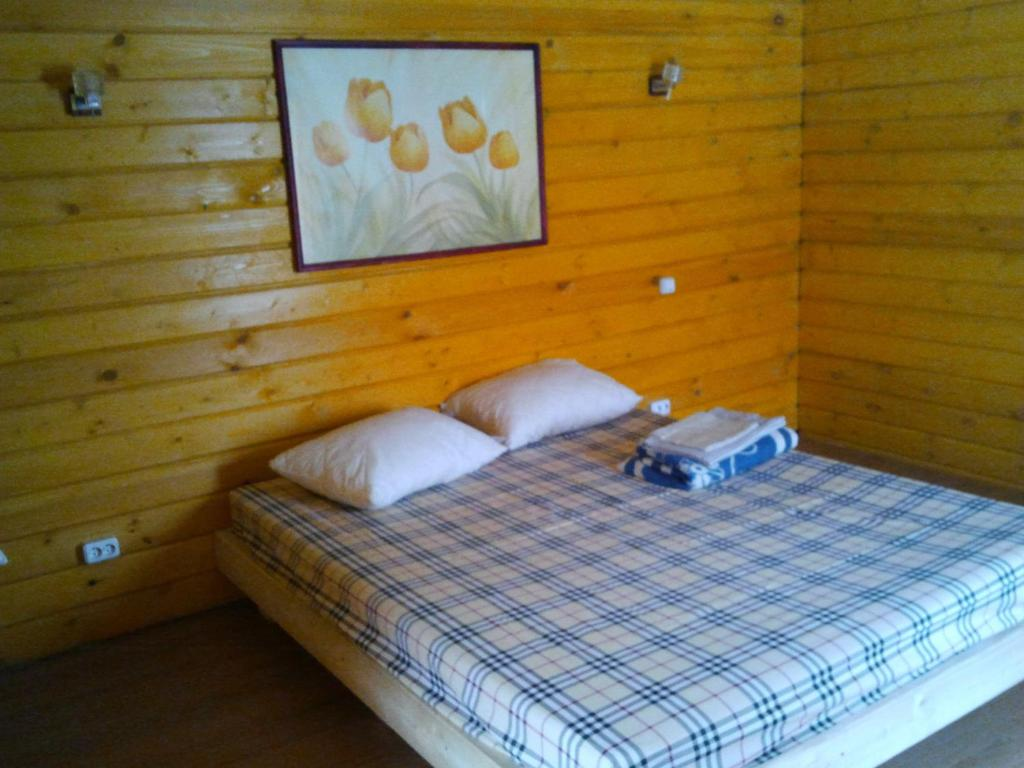 A bed or beds in a room at Guest House Aynur