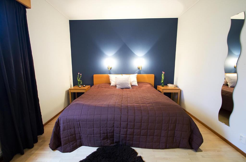 Säng eller sängar i ett rum på Havsbandet Pensionat