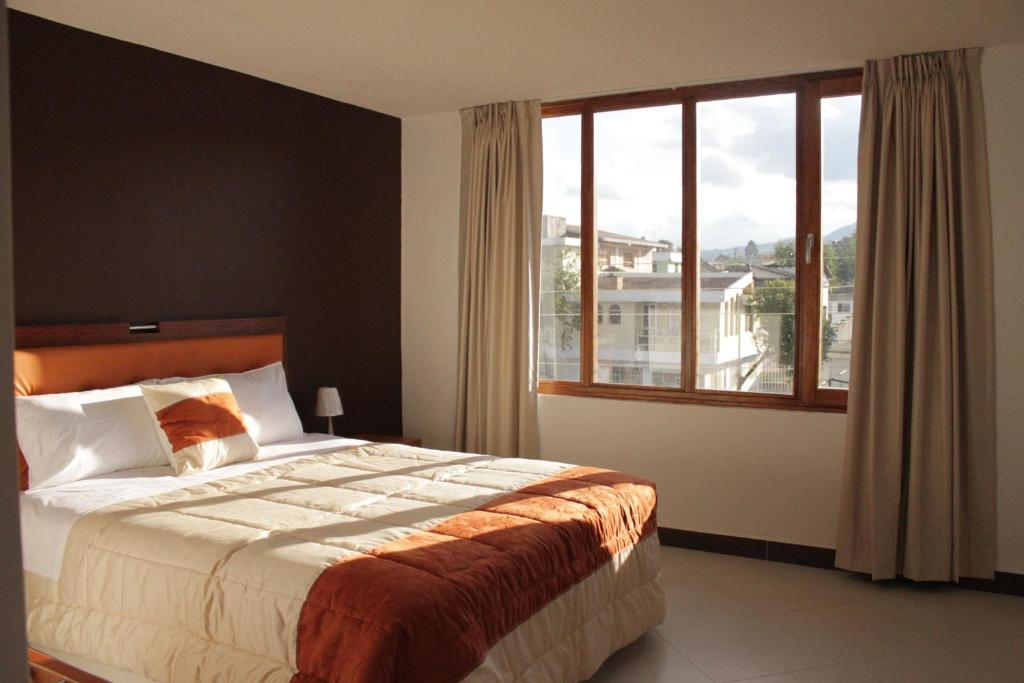A bed or beds in a room at Hotel Casa Sakiwa