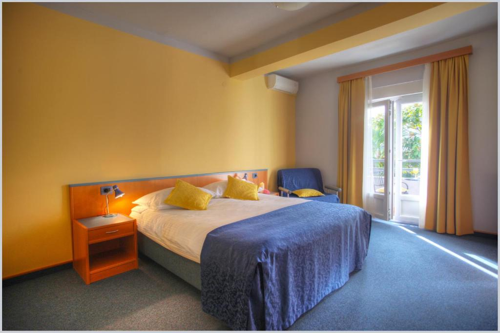 A bed or beds in a room at Guest Accomodation Tamaris