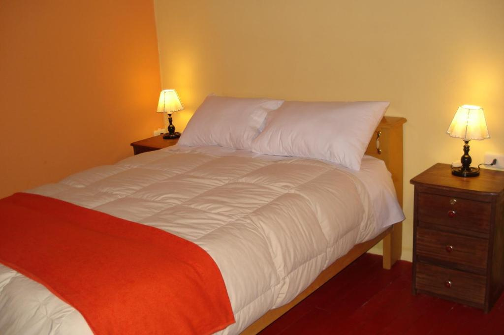 A bed or beds in a room at Barrio Inka BnB