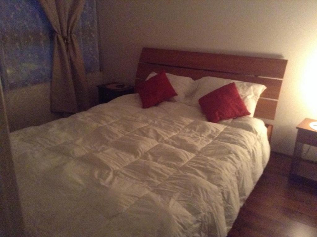 Cama o camas de una habitación en Capital