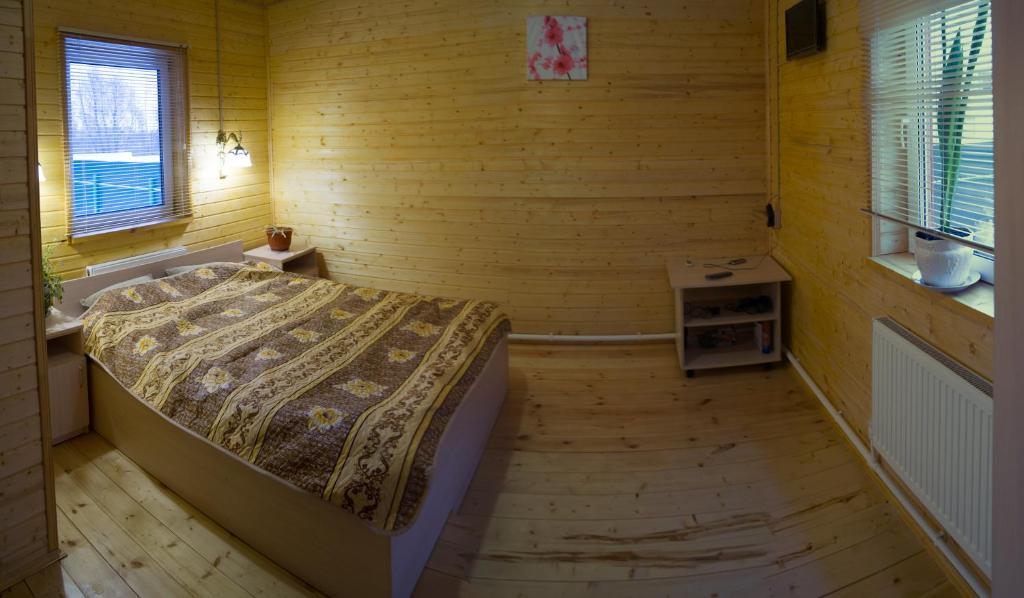 Кровать или кровати в номере Раманов Плес
