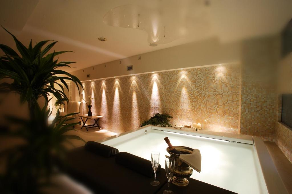 The swimming pool at or near Ponte Vecchio Suites & Spa