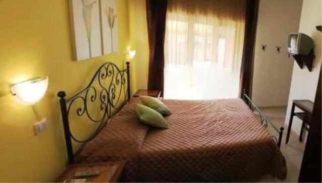 En eller flere senger på et rom på B&B Viadelmare