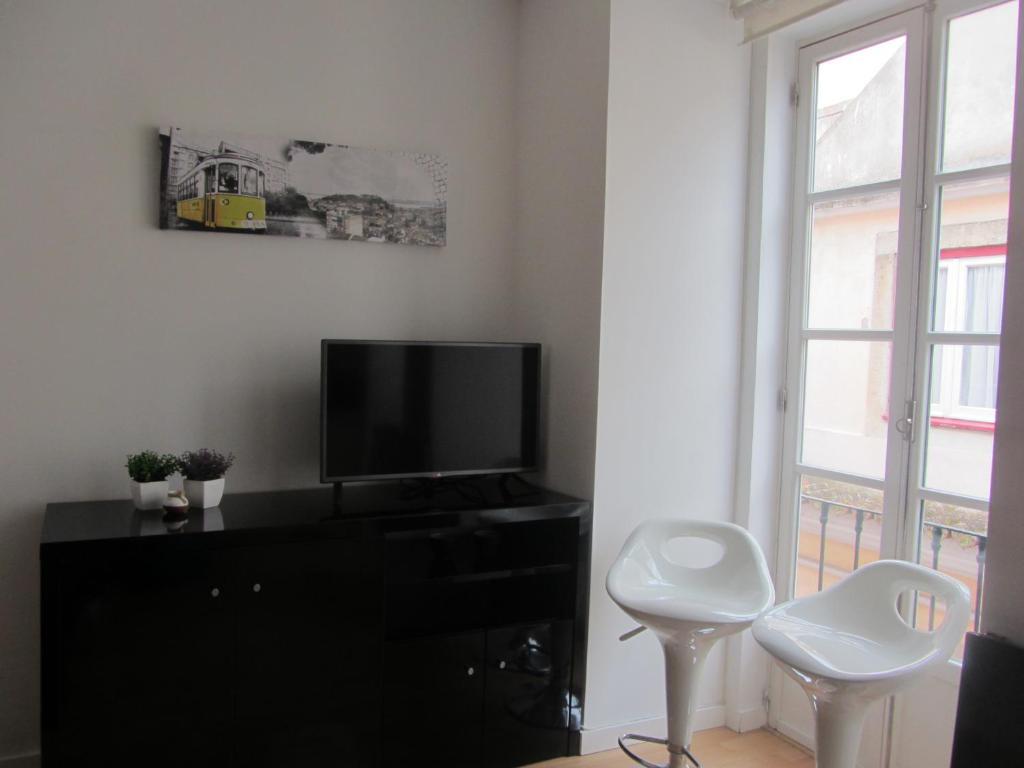 A television and/or entertainment center at Apartment Beco das Farinhas