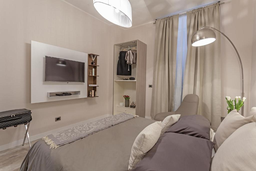 Un ou plusieurs lits dans un hébergement de l'établissement St. George's Vatican Suites
