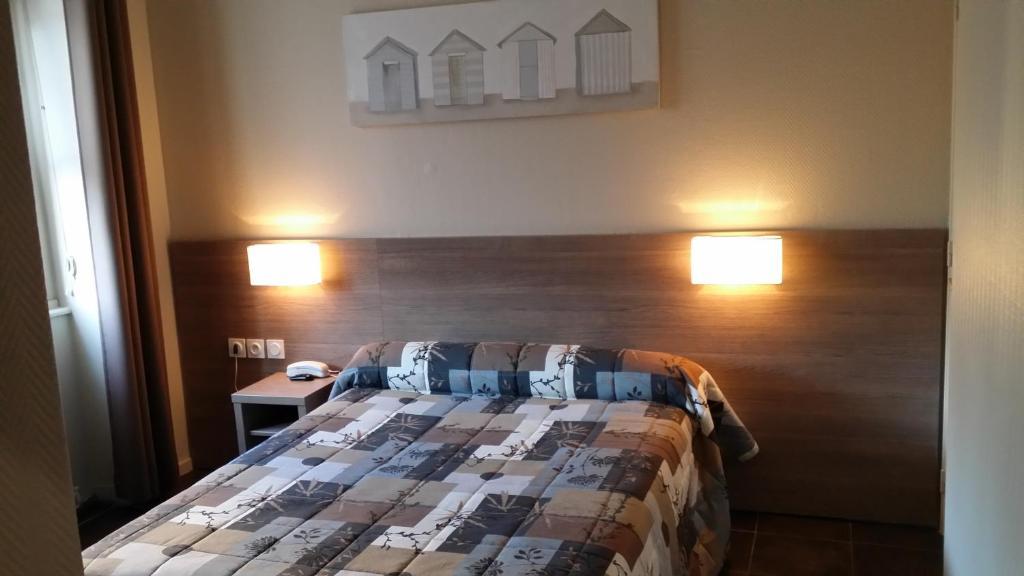 Cama o camas de una habitación en Hotel D'Ainay