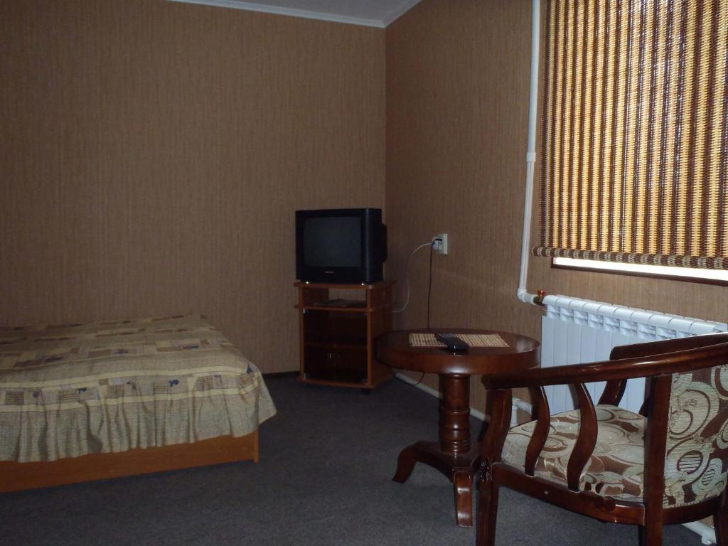 Кровать или кровати в номере Гостевой Дом Бай-Куль