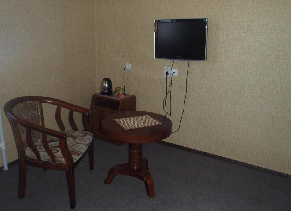 A television and/or entertainment center at Guest House Bai-Kul