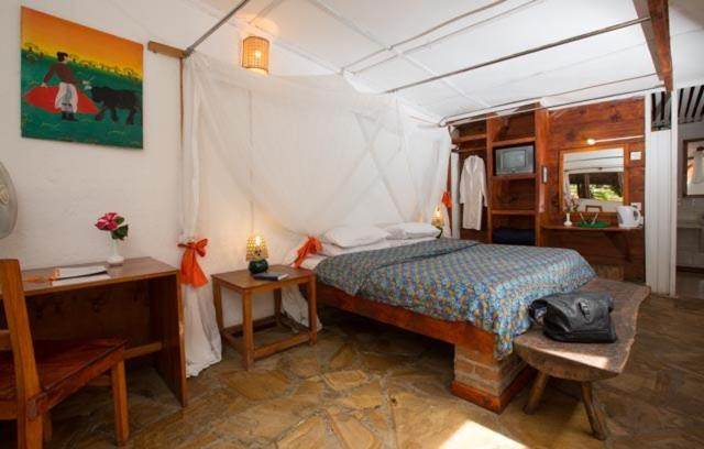 A bed or beds in a room at Outpost Lodge