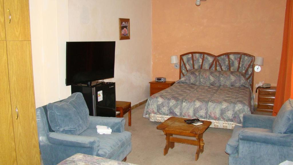 Tempat tidur dalam kamar di Hotel Durazno
