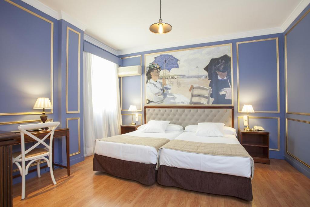 A bed or beds in a room at Casual de las Artes Valencia