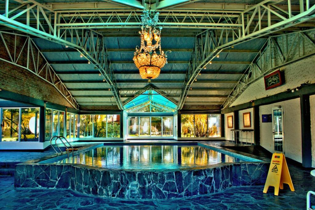 """The swimming pool at or near La Loma """"Self"""" Apart & Suites"""