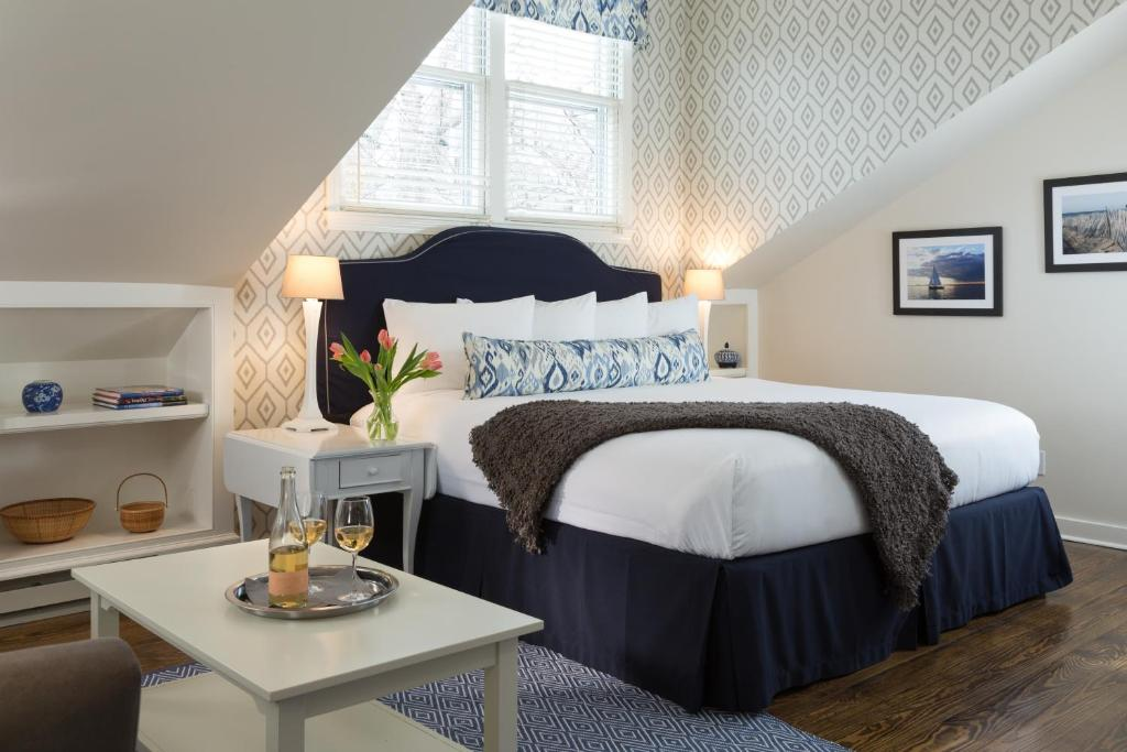 A bed or beds in a room at Brass Lantern Inn