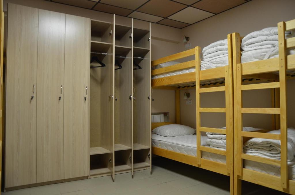 A bunk bed or bunk beds in a room at Hostel VShokoladi