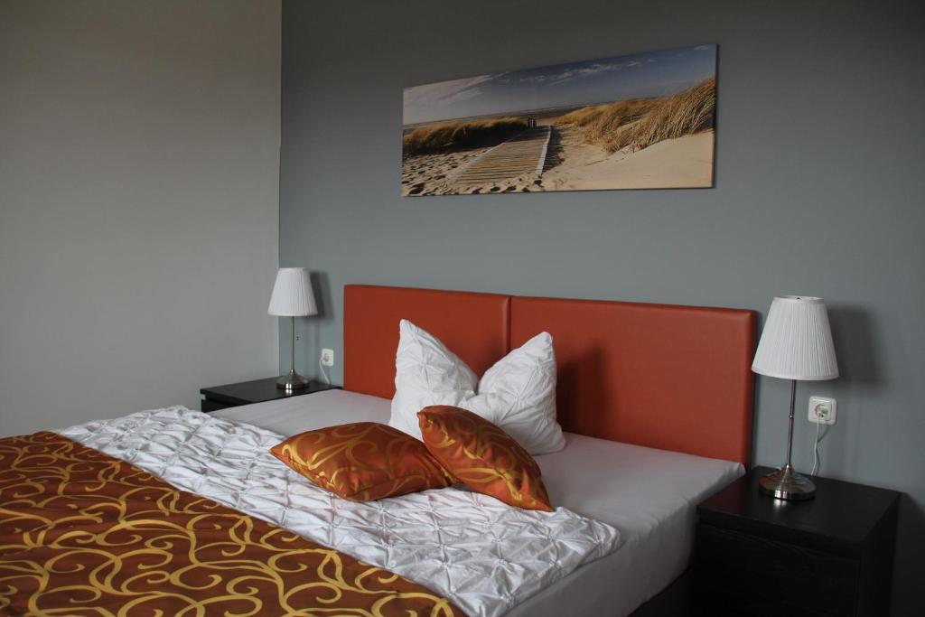 Ein Bett oder Betten in einem Zimmer der Unterkunft Apartmenthaus Unterwegs