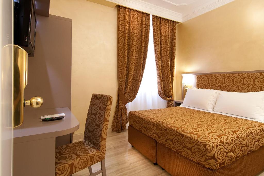 Krevet ili kreveti u jedinici u okviru objekta Hotel Fellini