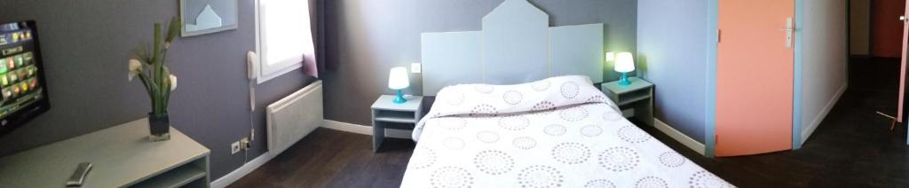 Un ou plusieurs lits dans un hébergement de l'établissement Hôtel Motelia