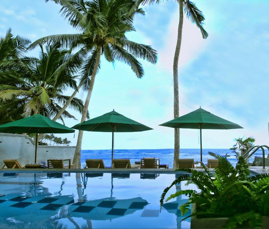 The swimming pool at or near Sea World Mirissa Beach